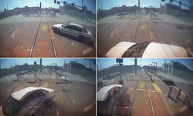 Moment driver veers directly in front of train but miraculously escapes