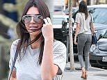 UK CLIENTS MUST CREDIT: AKM-GSI ONLY EXCLUSIVE: Kendall Jenner and a gal pal were seen out and about visiting a few retail stores. The young Reality TV Star seemed cool and even shared a big smile with our cameraman.   Pictured: Kendall Jenner Ref: SPL1007066  220415   EXCLUSIVE Picture by: AKM-GSI / Splash News