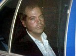 17 Dec 2003, Washington, DC, USA --- John Hinckley Jr. arrives at the E. Barrett Prettyman U.S. District Court in Washington in this November 19, 2003 file photo. A federal judge ruled December 17, 2003 that Hinckley, who tried to assassinate President Ronald Reagan in 1981, can make local visits with his family from the psychiatric hospital where he has been held. U.S. District Judge Paul Friedman endorsed a proposal by St. Elizabeths Hospital for six local day visits and then two local overnight visits within a 50-mile (80 km) radius of Washington, D.C. --- Image by © Brendan Smialowski/Reuters/Corbis