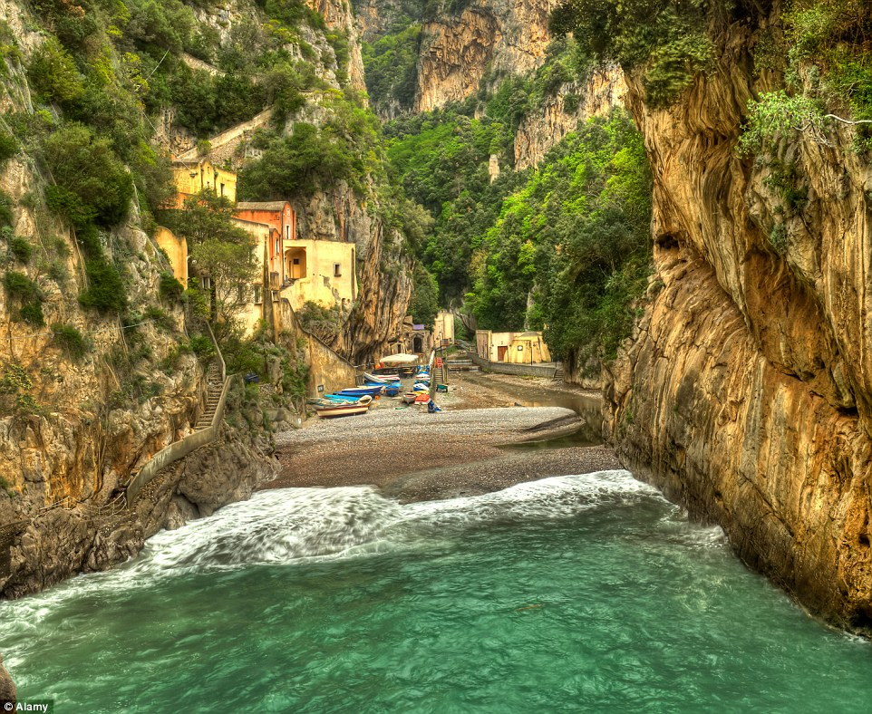 A village in a Fjord! Furore in Italy is a brightly coloured settlement tucked away in the mouth of the fjord
