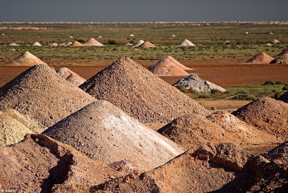 Giant mole hills? An entire population of over a thousand residents live underground in dugouts at Coober Pedy in northern South Australia