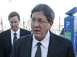 Nephi, left, and Lyle Jeffs leave the federal courthouse in Salt Lake City, Wednesday, Jan. 21, 2015. A federal judge says the brothers of polygamous sect leader Warren Jeffs can cite their religion in refusing to answer questions about suspected child labor violations on a Utah pecan farm. Nephi and Lyle Jeffs, who are considered high-ranking members of the secretive sect, testified that their church doctrine bars them from talking about the group's dealings. (AP Photo/Rick Bowmer)