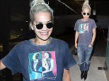Rita Ora wore a Madonna Blonde Ambition tee with jeans for her flight into LAX.  The pop star wore her white hair up, with shades and a playboy bunny pendant, on Thursday, April 23, 2015 X17online.com