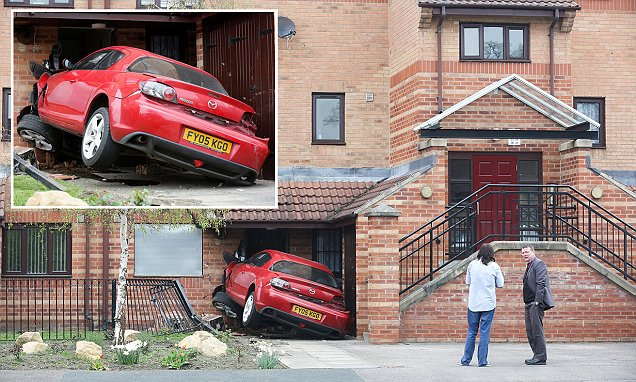 Honey, I'm home! Shocking image shows moment red Mazda careered off the road and smashed