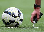 MANCHESTER, ENGLAND - AUGUST 16:  The Referee uses vanishing spray to mark the spot of a free kick during the Barclays Premier League match between Manchester United and Swansea City at Old Trafford on August 16, 2014 in Manchester, England.  (Photo by Alex Livesey/Getty Images)