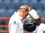 England's batsman Joe Root reacts as he leaves the field during day four of the second Test cricket match between the West Indies and England at the Grenada National Stadium in Saint George's on April 24, 2015. England lead by 165 runs at the end of the first innings. AFP PHOTO/JEWEL SAMADJEWEL SAMAD/AFP/Getty Images