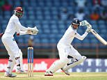GRENADA, GRENADA - APRIL 24:  Joe Root of England plays behind square as wicketkeeper Denesh Ramdin of West Indies looks on  during day four of the 2nd Test match between West Indies and England at the National Cricket Stadium in St George's on April 24, 2015 in Grenada, Grenada.  (Photo by Michael Steele/Getty Images)