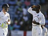 West Indies' Marlon Samuels salutes England's Ben Stokes, as Stoke leaves the field after being caught by West Indies' Jermaine Blackwood, on the third day of their second Test match at the National Stadium in St. George's, Grenada, Thursday, April 23, 2015. (AP Photo/Ricardo Mazalan)