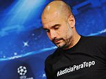 epa04713285 Bayern Munich's Spanish head coach Pep Guardiola attends a press conference in Munich, Germany, 20 April 2015. Guardiola wears a shirt reading #JusticiaParaTopo to commemorate Argentinian journalist Jorge 'Topo' Lopez, who died in a car crash during the FIFA 2014 World Cup in Brazil. Bayern Munich will face FC?Porto in the UEFA Champions League quarter final second leg soccer match on 21 April 2015.  EPA/ANDREAS GEBERT
