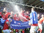 Bristol City's players celebrate winning the league during the Sky Bet League One match at Ashton Gate, Bristol. PRESS ASSOCIATION Photo. Picture date: Saturday April 18, 2015. See PA story SOCCER Bristol City. Photo credit should read: PA Wire. RESTRICTIONS: Editorial use only. Maximum 45 images during a match. No video emulation or promotion as 'live'. No use in games, competitions, merchandise, betting or single club/player services. No use with unofficial audio, video, data, fixtures or club/league logos.