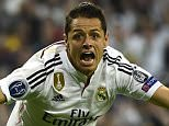 TOPSHOTS Real Madrid's Mexican forward Javier Hernandez celebrates after scoring a goal during the UEFA Champions League quarter-finals second leg football match Real Madrid CF vs Club Atletico de Madrid at the Santiago Bernabeu stadium in Madrid on April 22, 2015.     AFP PHOTO / PIERRE-PHILIPPE MARCOUPIERRE-PHILIPPE MARCOU/AFP/Getty Images