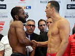 Heavyweight boxers Bryant Jennings, left, from Philadelphia, and Wladimir Klitschko, from Ukraine, shake hands after their weigh-in, Friday, April 24, 2015, in New York. Klitschko will put his four heavyweight championships on the line against the unbeaten Jennings on Saturday night at Madison Square Garden. (AP Photo/Richard Drew)