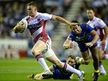 Joe Burgess of Wigan Warriors breaks the tackle of Stefan Ratchford and Joel Monaghan of Warrington Wolves during the First Utility Super League Qualifying Semi-Final match between Wigan Warriors and Warrington Wolves at DW Stadium on October 3, 2014 in Wigan, England.  (Photo by Gareth Copley/Getty Images)