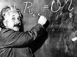 Dr. Albert Einstein writes an equation for the density of the Milky Way on the blackboard at the Carnegie Institute, Mt. Wilson Observatory headquarters in Pasadena, Calif., in this Jan. 14, 1931 file photo. Einstein achieved world reknown in 1905, at age 26, when he expounded a theory of general relativity which proposed the existence of atomic energy. Though his concepts ushered in the atomic age, he was a pacifist who warned against the arms race. He was awarded the Nobel Prize for Physics in 1921.  (AP Photo)