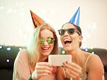 A stock photo of two female friends taking selfie during Christmas party.