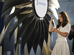 Catherine, Britain's Duchess of Cambridge, reacts after she officiates the launch of the first aero engine and fan blades produced in Singapore at the Rolls Royce Seletar campus, September 12, 2012. Prince William and Catherine are on their first stop of a nine-day tour of Southeast Asia and the South Pacific on behalf of Queen Elizabeth II to commemorate her Diamond Jubilee.  REUTERS/Gary Goh/The New Paper  (SINGAPORE - Tags: ROYALS ENTERTAINMENT BUSINESS TRANSPORT) NO SALES. NO ARCHIVES. THIS IMAGE HAS BEEN SUPPLIED BY A THIRD PARTY. IT IS DISTRIBUTED, EXACTLY AS RECEIVED BY REUTERS, AS A SERVICE TO CLIENTS. SINGAPORE OUT. NO COMMERCIAL OR EDITORIAL SALES IN SINGAPORE