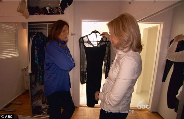 Secret closet: Bruce Jenner showed Diane Sawyer one of his favourite new little black dress that looked just like one owned by Kourtney Kardashian, which he pulled from a wardrobe full of women's clothing and heels