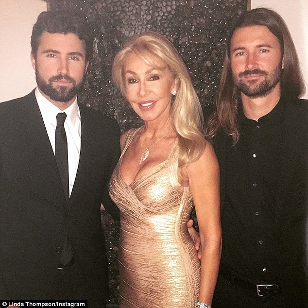 Keeping the secret: Linda, seen here in April with her sons  Brandon and Brody Jenner, has kept silent about her former husband's conviction that he is female. The revelation he made to her during their marriage contributed to their divorce