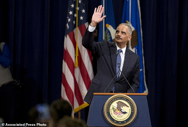 Attorney General Eric Holder waved to Justice Department employees during his farewell gathering in Washington on Friday, ending six years at the DOJ