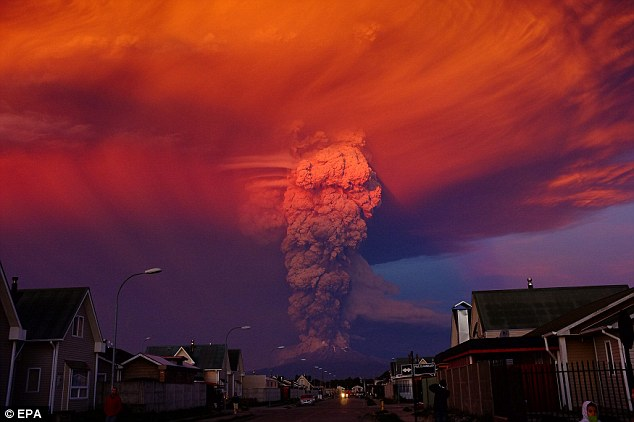 Up in smoke: Volcano Calbuco, in southern Chile, erupted forcing 1,500 residents from Ensenada, about 10 miles away,  to flee their homes