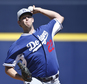 FILE - In this March 15, 2015, file photo, Los Angeles Dodgers starting pitcher Clayton Kershaw works against the Seattle Mariners in the first inning of a s...