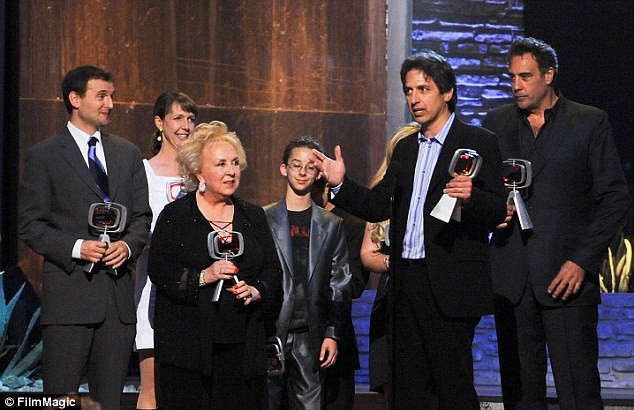 The child actor, centre, appeared on stage with the show's cast in 2010 to accept a gong at the 8th Annual TV Land Awards