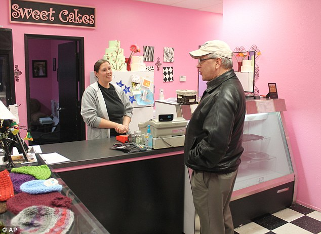 Melissa Klein (behind counter) of Sweet Cakes by Melissa faces a $135,000 fine after being found guilty of discriminating against a lesbian couple when she and her husband refused to make them a wedding cake