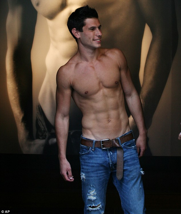 Say goodbye: According to plans unveiled by the retailer on Friday, Abercrombie's iconic shirtless models will no longer be featured in any of its stores