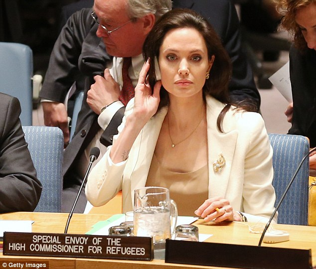 Jolie listens into the discussion on Syria and the plight of refugees in the Middle East on Friday morning