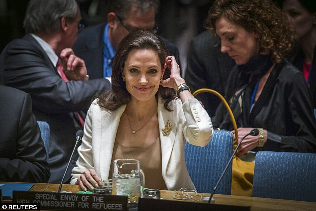 United Nations High Commissioner for Refugees (UNHCR) special envoy, actress Angelina Jolie smiles before speaking to members