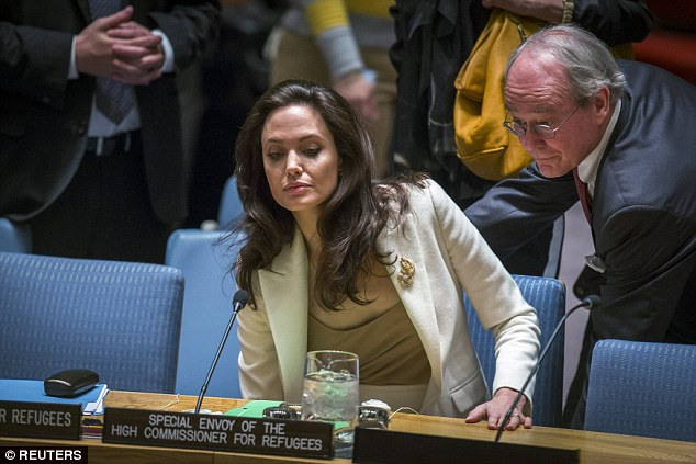 Angelina Jolie was helped into her seat at the UN on Friday where she made berated world powers for not doing enough to help Syria and urged them to come together for resolution