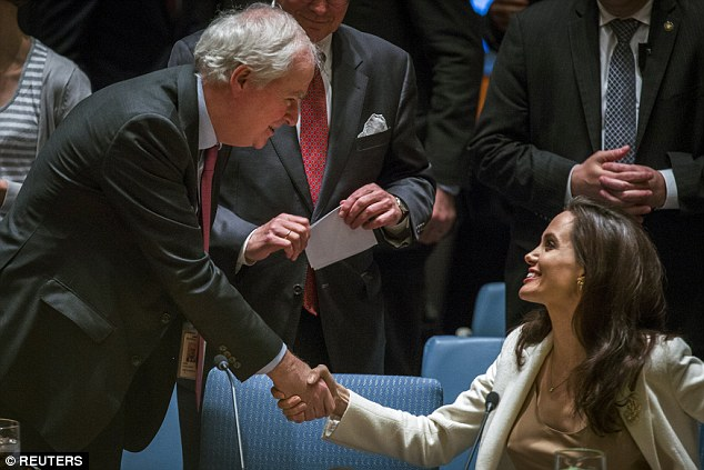 Fans: Angelina Jolie greets Permanent Representative of the United Kingdom to the UN, Mark Lyall Grant, before a meeting at the United Nations Headquarters in Manhattan