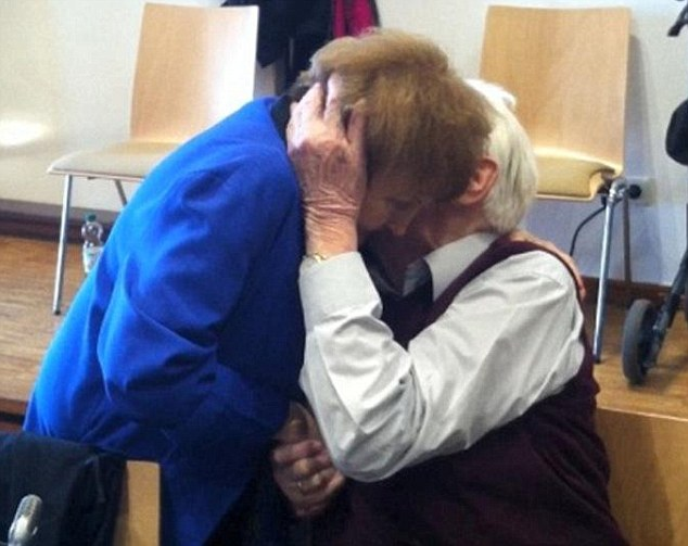 Embrace: Seventy years after Auschwitz was liberated, Eva Kor embraces former Nazi guard Oskar Groening