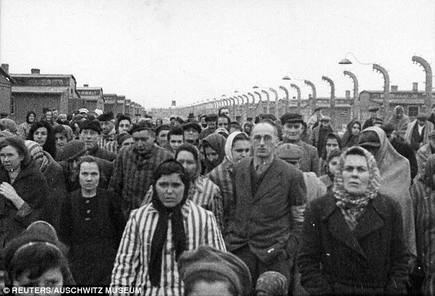 Between May 16 and July 11, 1944, Groening was on duty when 450,000 Hungarian Jews were transported there, with 300,000 being gassed just after arrival. Pictured, Auschwitz survivors