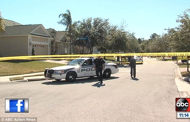 Scene: Police surround the couple's upscale home in Tampa following the discovery of the bodies