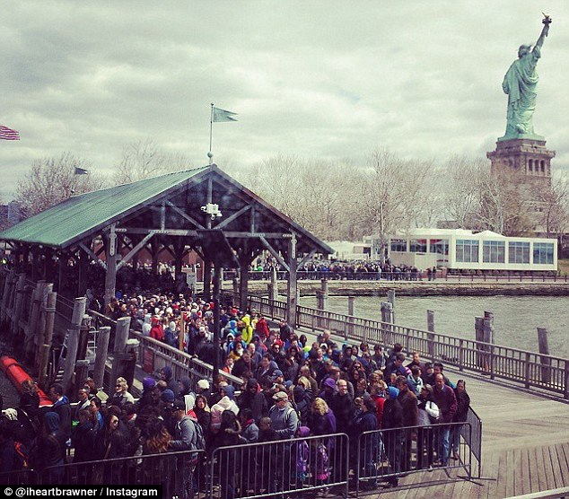 Evacuation: Tourists were rushed off Liberty Island today following a bomb threat resulting in a suspicious package being found. This Instagram image shows hundreds of tourists waiting at a pier to catch a boat to safety