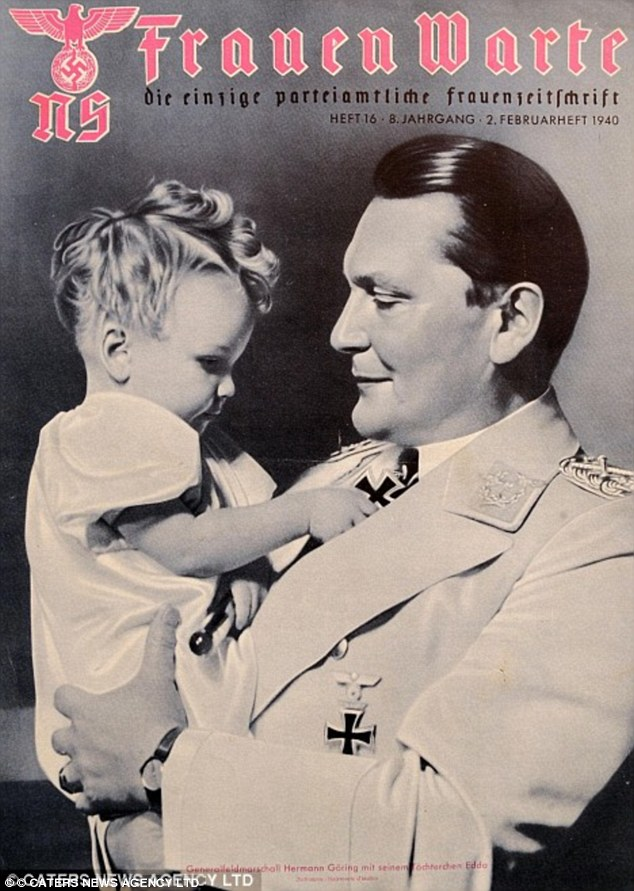 Showing his soft side: Hermann Goering appears on the front cover of a magazine with daughter Edda in 1940