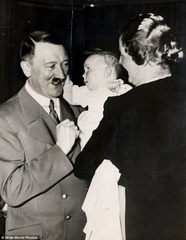 Hitler's goddaughter:EddaGoering, pictured at her christening with Hitler in 1938,has failed in her bid to get the state of Bavaria to return family money confiscated after the collapse of the Third Reich