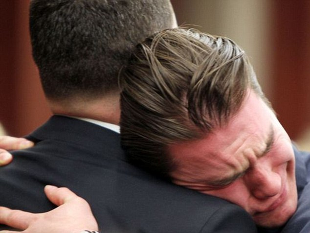 Tears of relief: Loved ones of Ryan Poston sob and embrace in reaction to Hubers' guilty verdict