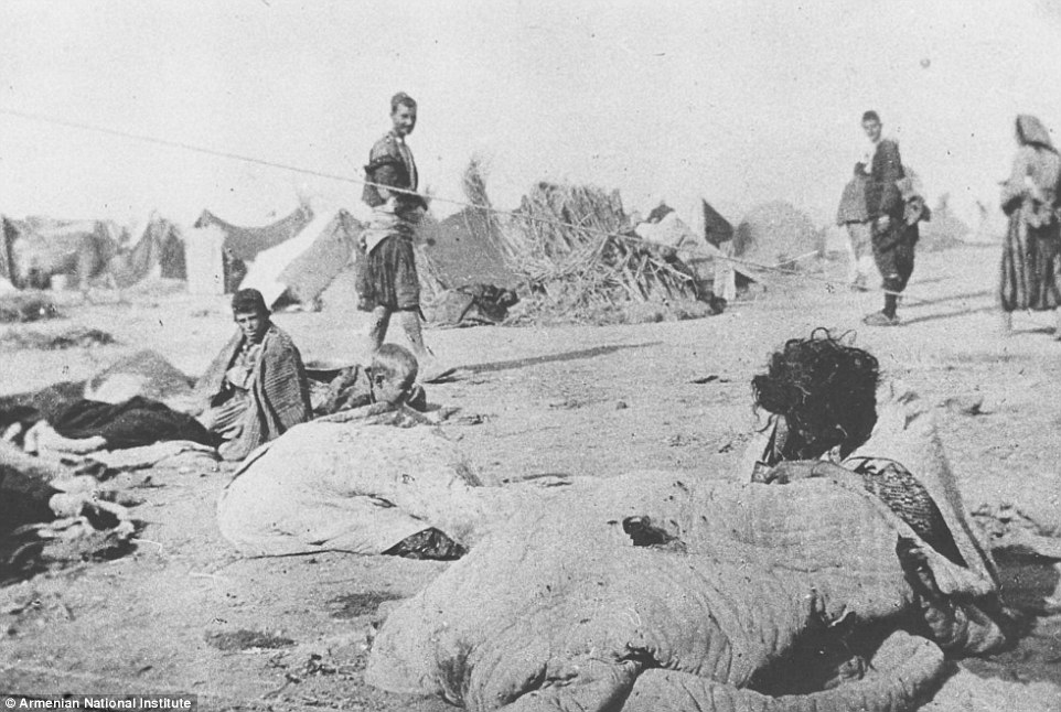 Armenian deportees living in the open desert with bedding as their only shelter, though luckier families in the background have tents