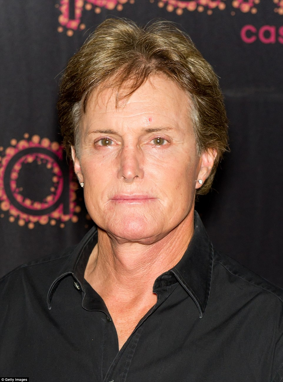 Ear-ily feminine: Bruce made headlines when he pierced both of his ears in 2011; in 2012 (pictured here), he upgraded from simple gold studs to flashy diamonds