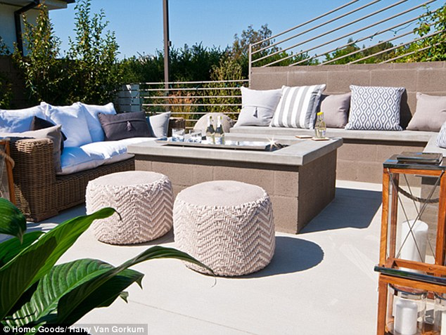 Kick back and relax! The patio was complete with a brick centreprice were beverages sat