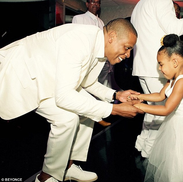 Dancing with my father: The adorable three-year-old was also snapped dancing with her 45-year-old rap mogul father as he hunched down to hold her hands at the event that happened in Newport Beach earlier this month