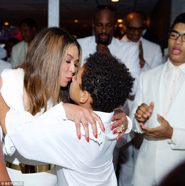 Family love: The 61-year-old is pictured giving a kiss to Solange's son Daniel