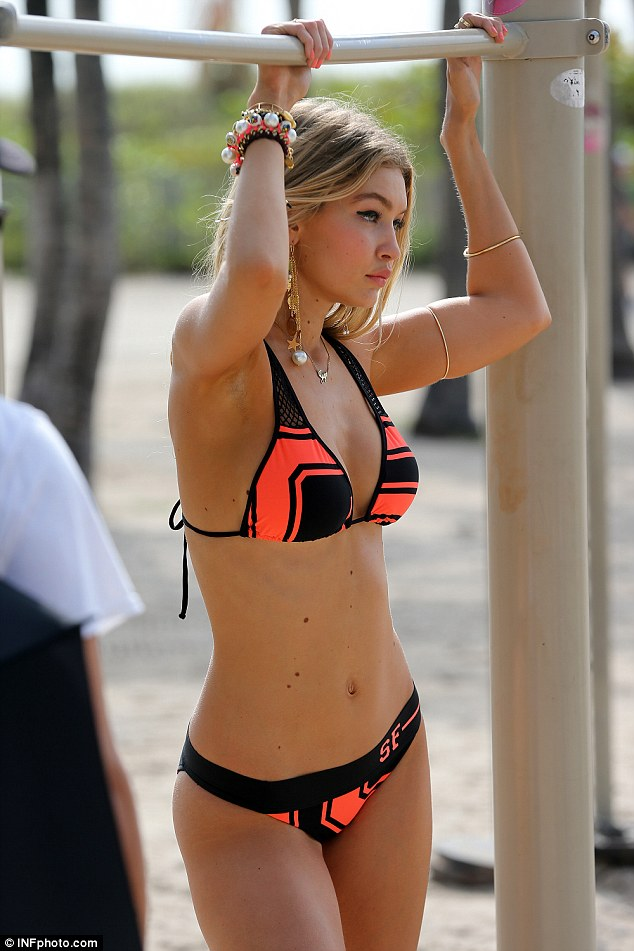 Fierce: The blonde beauty was seen sporting a bold cat eye as she modeled the stylish pink and black bikini