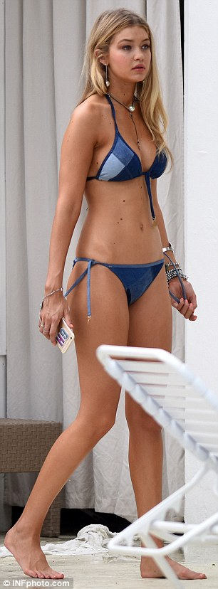 Double denim: Gigi changed into the patchwork bikini, and then slipped a denim shirt over the top