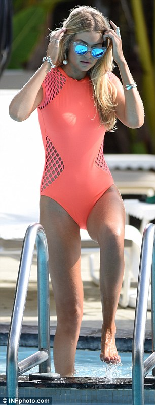 Futuristic: Her most unusual ensemble was a coral one-piece with mesh sleeves and panels, and mirrored sunglasses