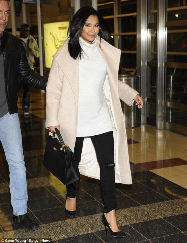 Sophisticated: The raven-haired beauty jet into Washington D.C. on Thursday, wearing a regal cream coloured coat, a white turtleneck, ripped black jeans, and black pumps