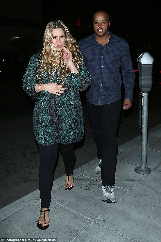 Round two: CaCee and Donald went to dinner in Beverly Hills last month, as the almost full term mom walked with her hand on her tummy