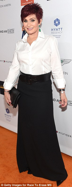 Simple yet chic: Kelly wore a colour-blocked dress, and her mother donned a white blouse and black maxi skirt